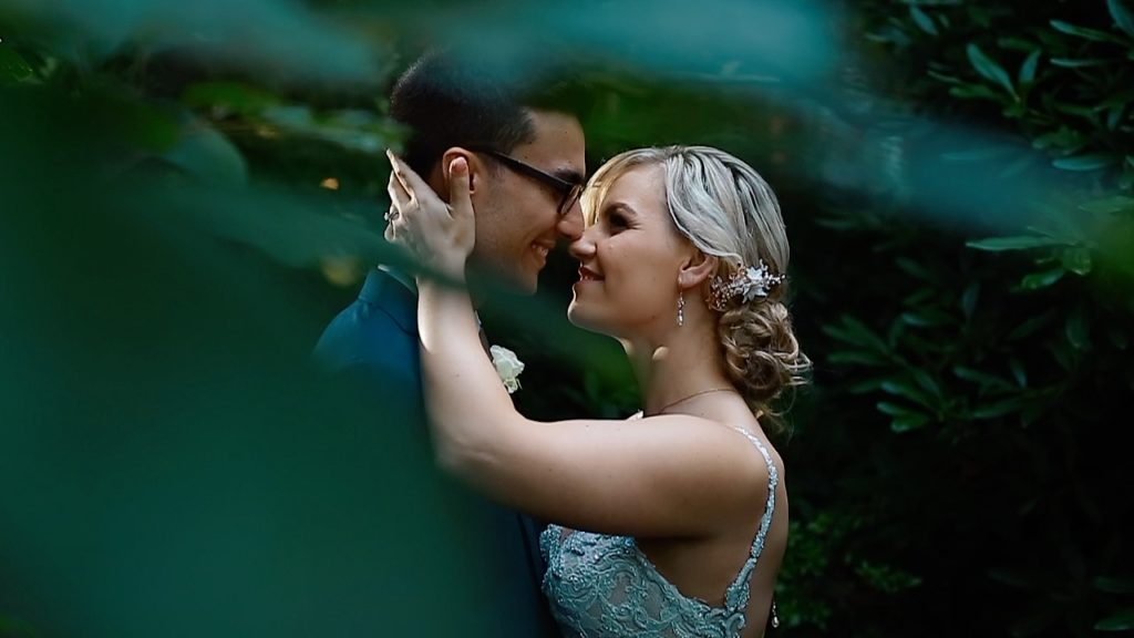 Kissing couple in garden Melbourne Wedding Videography and Photography