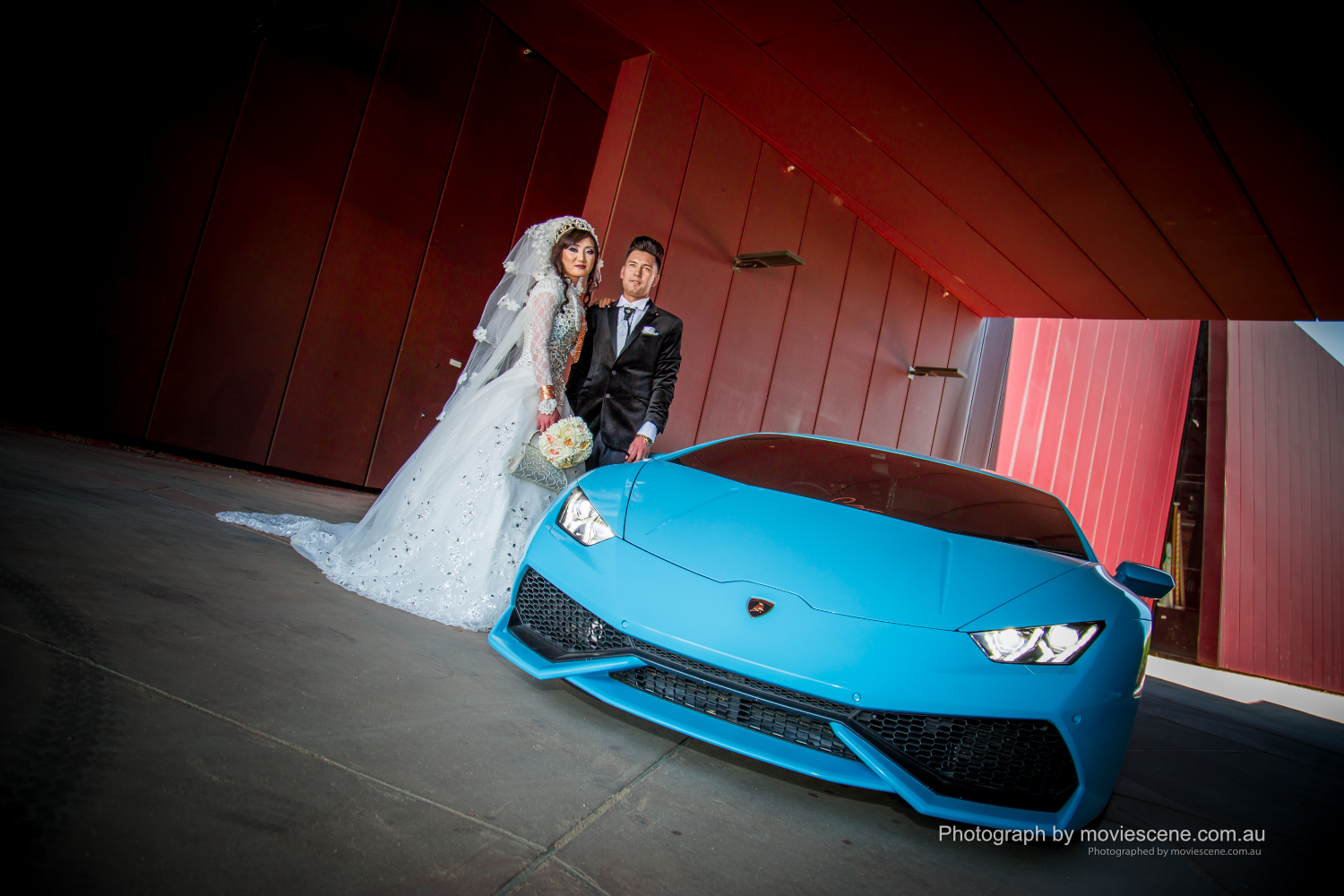 Melbourne Bride and groom with a blue Lamborgini Wedding Videography and Photography